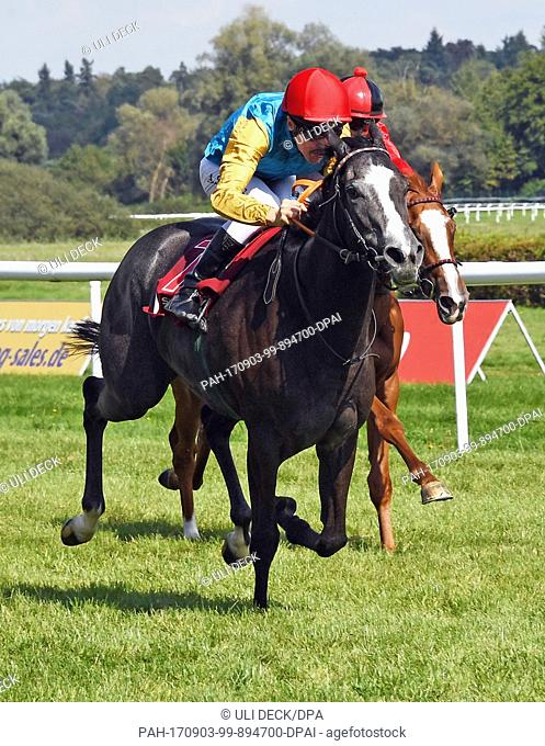 The Dutch jockey Adrie de Vries (R) wins the 144th Steinhoff race with his horse Narella on the 6th racing day in Iffezheim, Germany, 3 September 2017