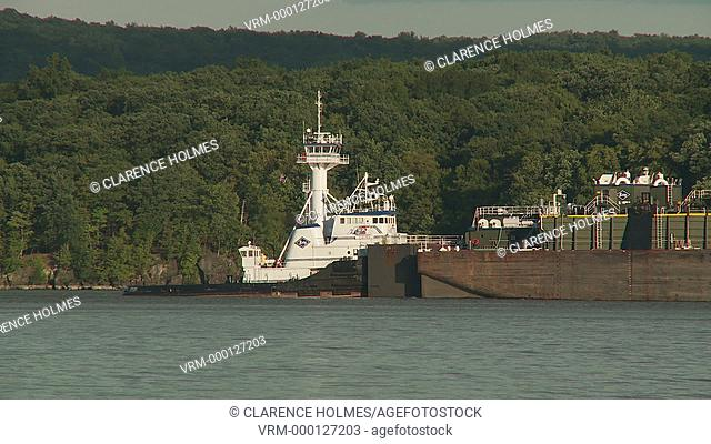 BUCHANAN, NY - SEPTEMBER 3: Kirby tugboat Viking pushes tank barge DBL 134 south on the Hudson River on September 3, 2013 near Buchanan