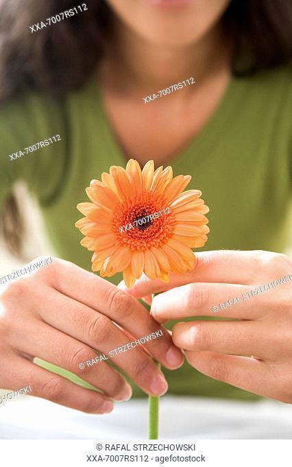 Woman with orange flower