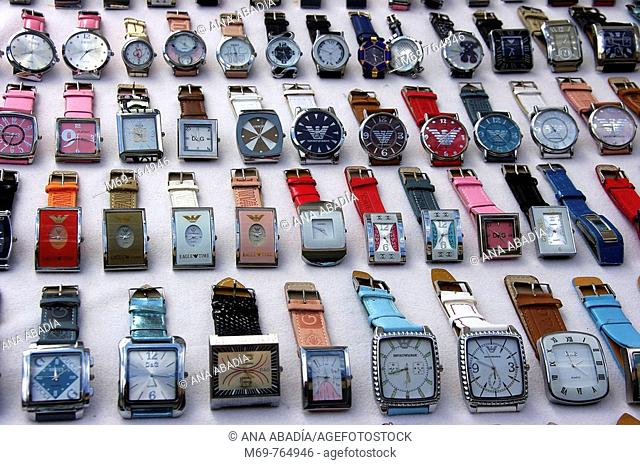 Watches for sale at market, Santanyi. Majorca, Balearic Islands, Spain