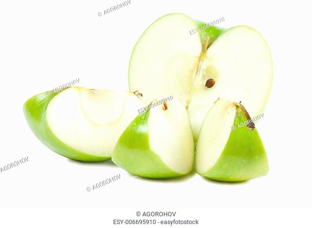 Parts of big green apple isolated over white background