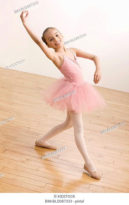 Hispanic girl dancing in ballet tutu