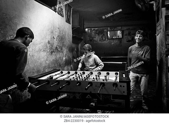 Youngs playing table football in a games shop. Marrakesh or Marrakech, Morocco, North Africa