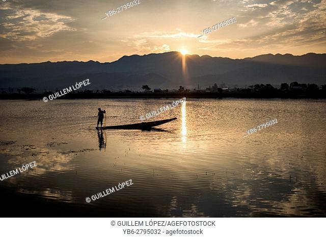Fisherman working at the Tharzi Pond at sunset time, Nyaungshwe, Myanmar