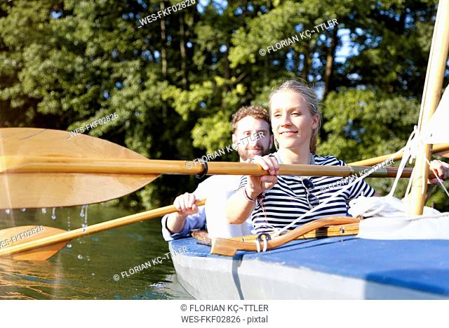Young couple enjoying a trip in a canoe on a lake