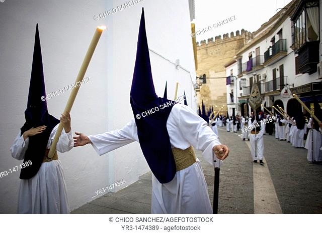 Penitents perform in an Easter Holy Week procession in Carmona village, Seville province, Andalusia, Spain, April 19, 2011