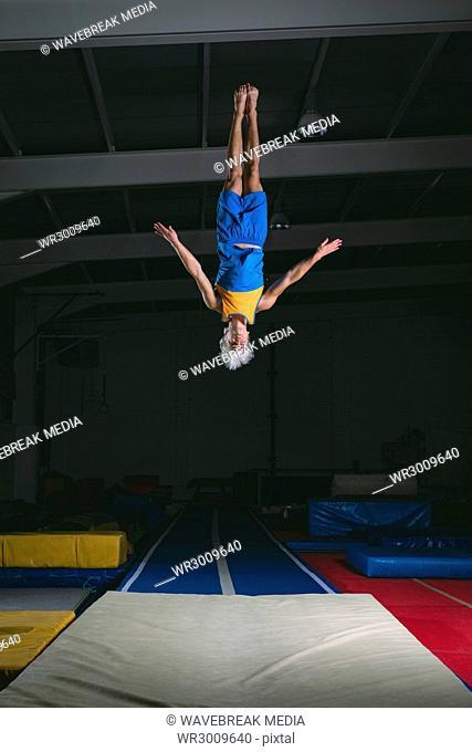 Male gymnast practicing gymnastic exercise