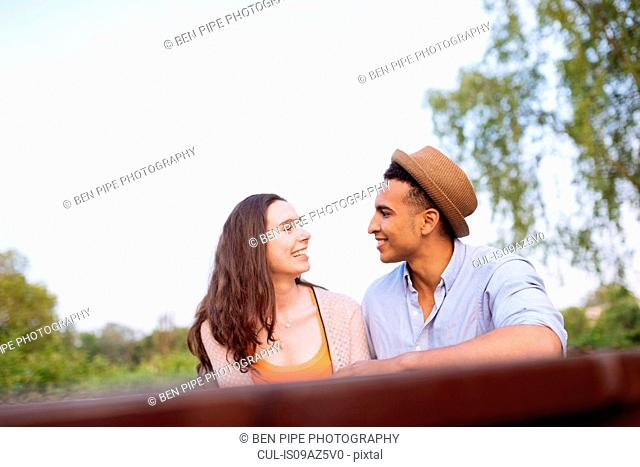 Young couple face to face smiling