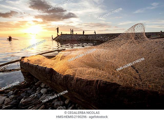 Indonesia, Lesser Sunda Islands, Alor Island, Kokar, Fishnets and boats on the seaside