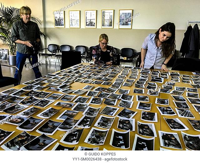 The Hague, Netherlands. Workshop Image Selection in progress, at agency Hollandse Hoogte. Training of skills for photographers and Photo Journalists is...