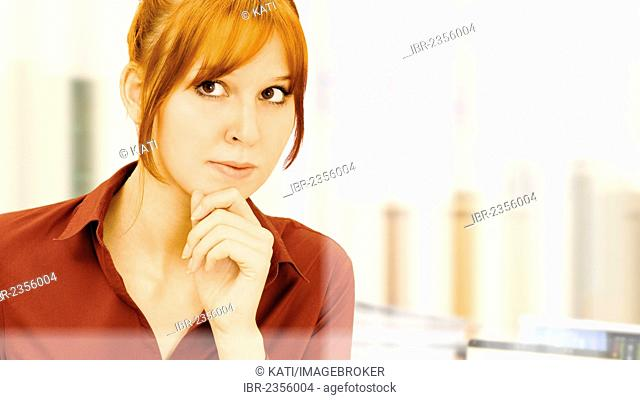 Focused, thoughtful young businesswoman in an office