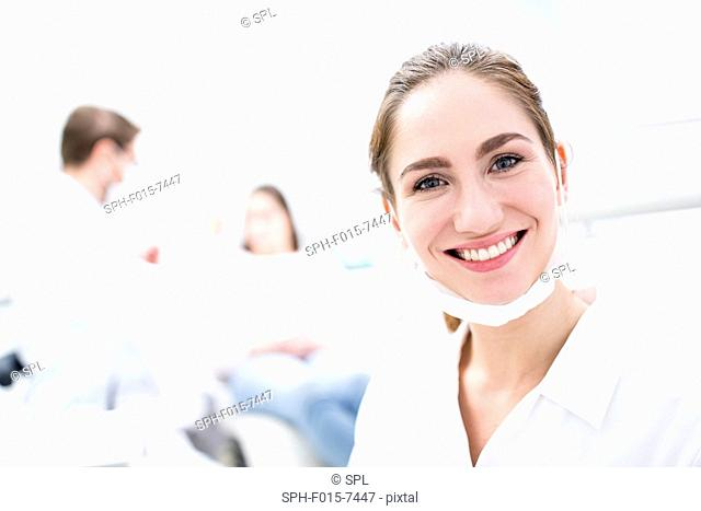 MODEL RELEASED. Close-up of young woman dentist, portrait