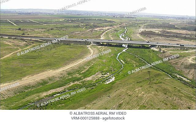 Aerial footage of a bridge in the desert