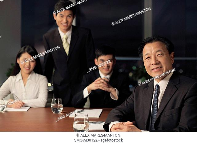 Four people having a business meeting