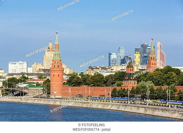 Russia, Moscow, River Moskva, Kremlin wall with towers and modern architecture