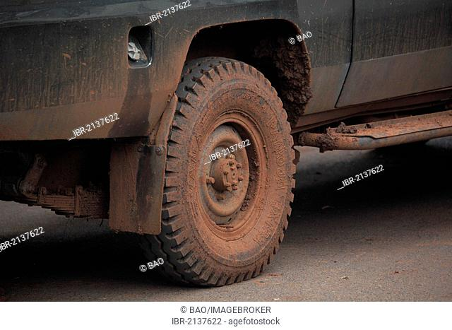 Jeep tyres after driving along muddy slopes, Tanzania, Africa