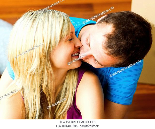 Close-up of couple moving to new house and kissing