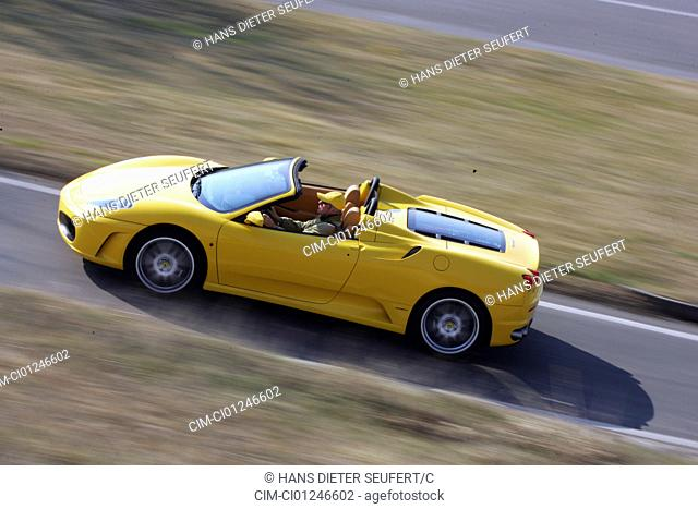 Car, Ferrari F430 Spider, model year 2005-, yellow, Convertible, driving, side view, open top, country road
