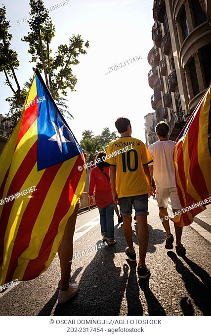 Catalan people holding a independence flag and lining up to form a seven-mile long V for vote on self-determination referendum scheduled on 9 November