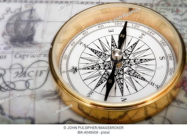 Old fashioned compass on an antique map