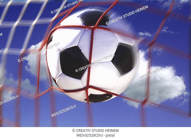Football in a football net, composing