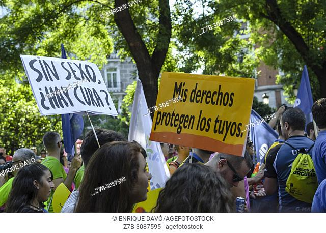 Madrid, Spain, 7 th July 2018. Gay pride parade with participants and placards in Paseo del Prado, 7 th July 2018, Madrid