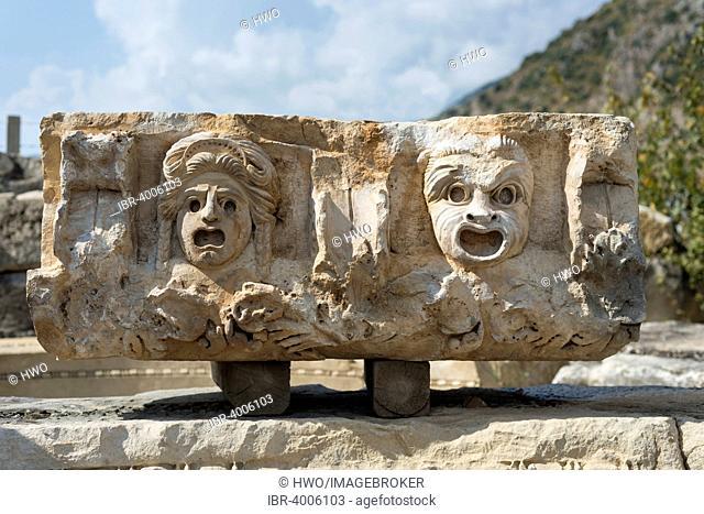 Theatre masks, reliefs on stone block from the Roman amphitheatre, ancient city of Myra, Demre, Antalya Province, Turkey