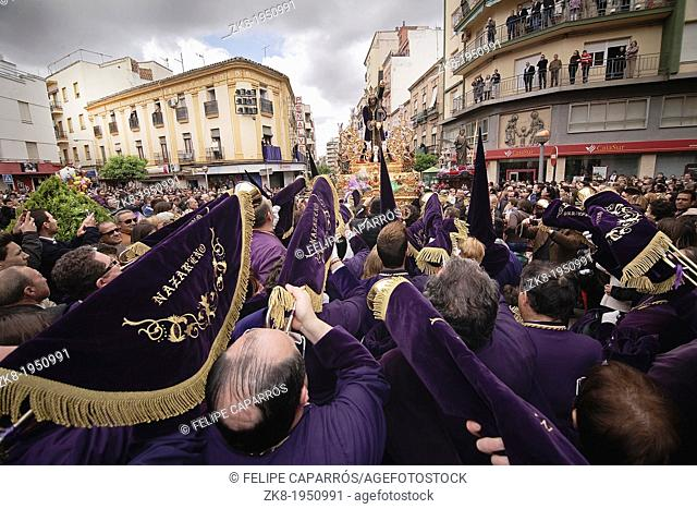 Penitents to playing their trumpets in a Holy week procession to the Nazarene, Holy Friday, Linares, Jaen province, Spain