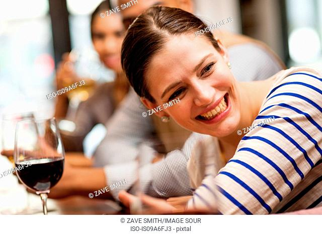Woman leaning forward on bar