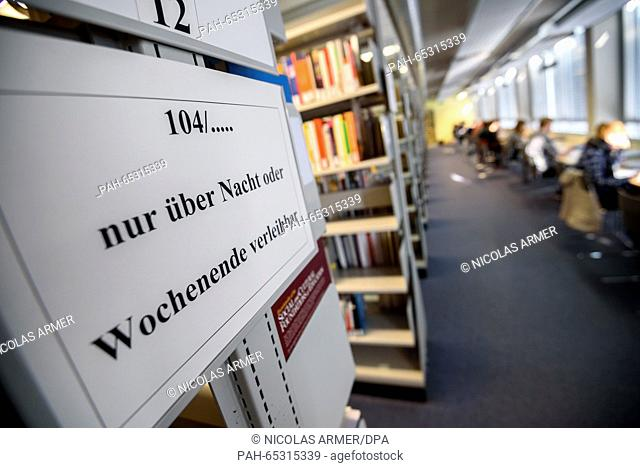 Students of Bayreuth University sit with their laptops in the university's central library in Bayreuth, Germany, 21 Janaury 2016