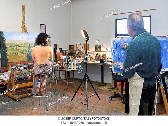 painter painting a model in the studio