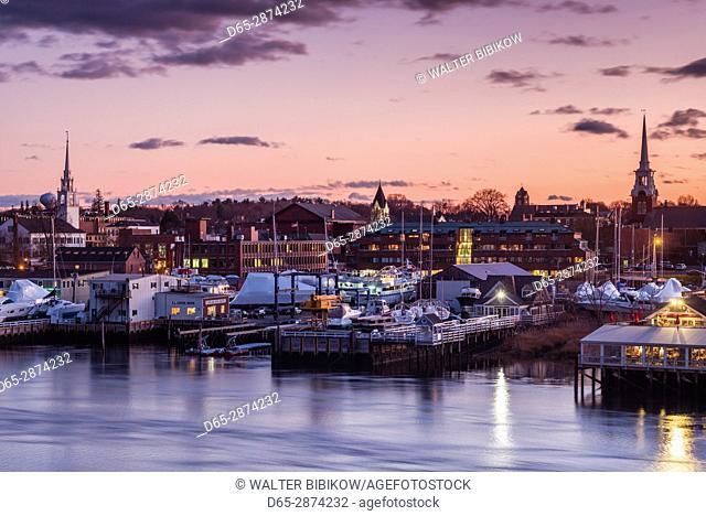 USA, Massachusetts, Newburyport, skyline from the Merrimack River, dusk