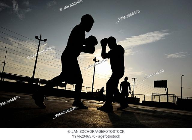 Peruvian youths workout at a sparring session at the Boxeo VMT boxing club in an outdoor gym in Lima, 2 April 2013. Boxeo VMT is a grassroots organisation...