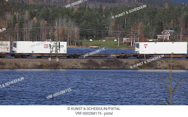 A cargo train is traversing a lake in Sweden. Björnsjö, Västernorrlands Län, Sweden