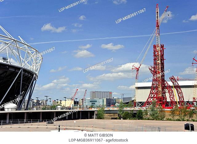 England, London, Stratford. Construction of the ArcelorMittal Orbit designed by Anish Kapoor alongside the Olympic stadium in London's Olympic Park