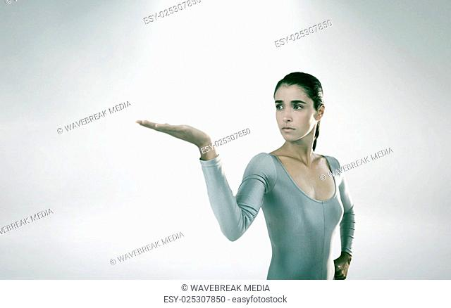 Composite image of young woman gesturing against white background