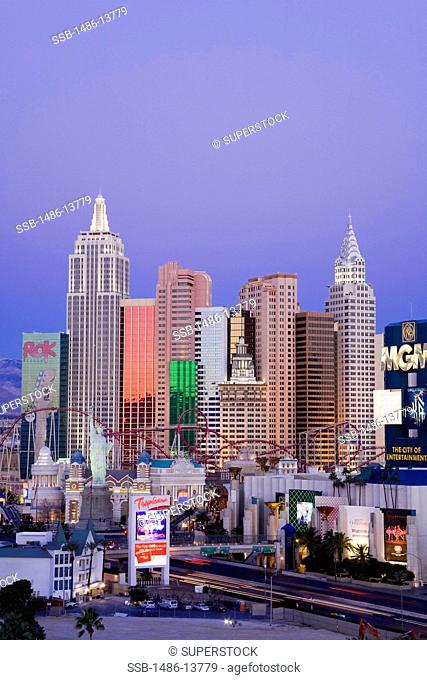 Hotels and skyline in a city at dawn, New York New York Hotel, The Strip, Las Vegas, Nevada, USA