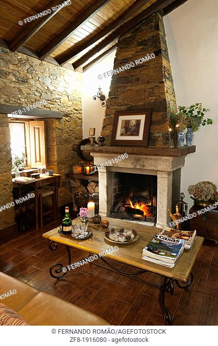 Living-room with fireplace set, at a rural house tourism, Góis-Portugal