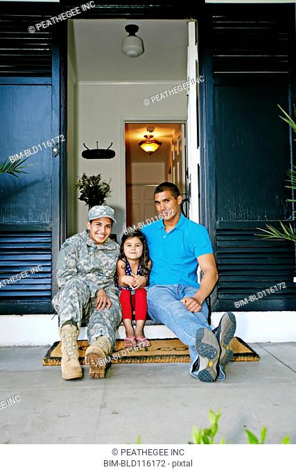Soldier mother with daughter and husband