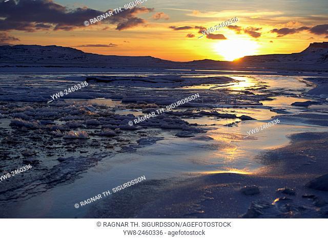 Winter sunset over frozen landscape, Holtavorduheidi, Iceland