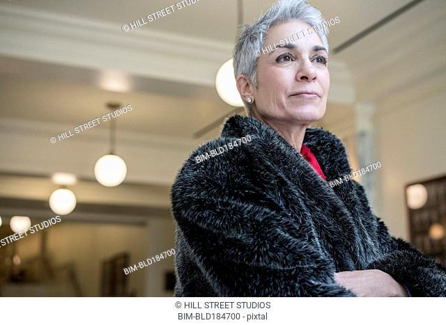 Older Caucasian woman wearing fur coat