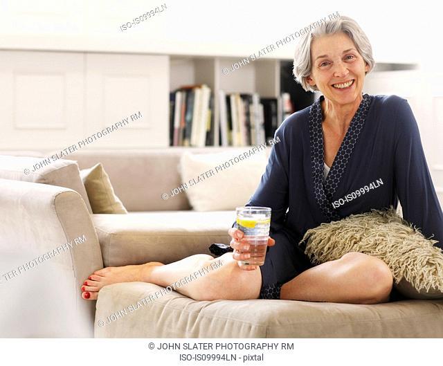 Senior woman in relaxing in robe, portrait