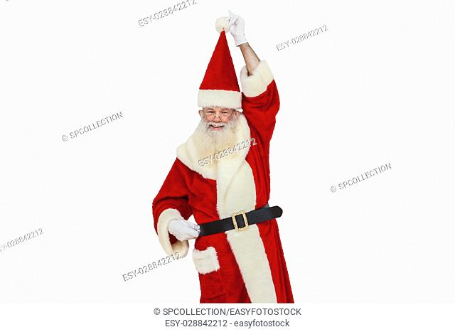 Santa Claus with real beard holding his hat (isolated)