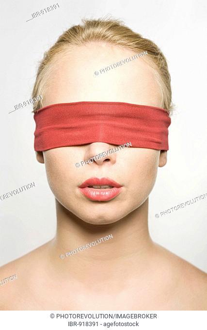 Young blonde woman, bandaged eyes