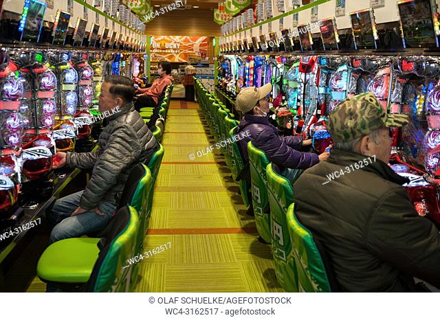 24. 12. 2017, Kyoto, Japan, Asia - Japanese people play with the Pachinko gaming machines in a parlour in Kyoto. Japan generates over 4% of its annual GDP