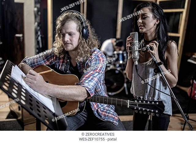 Singer and guitarist in recording studio