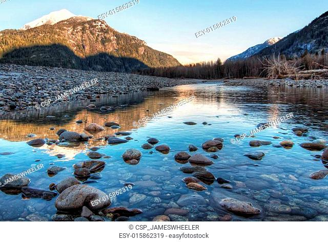 River Leading Towards Sunset Lit Mountains