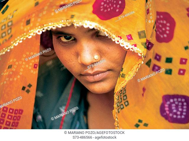 Indian woman's face, wearing a sari. New Delhi. India