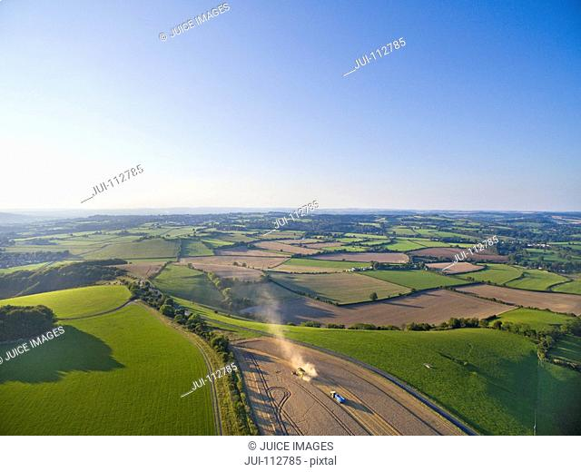 Scenic aerial landscape view of farmland and rural countryside under blue sky