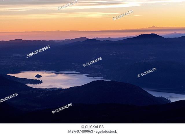 View of the Lago d'Orta and Isola di San Giulio from the top of Mottarone. Stresa, Verbano Cusio Ossola, Piedmont, Italy